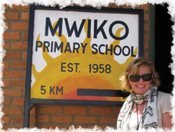 Jerri Hatch with Mwiko Primary sign